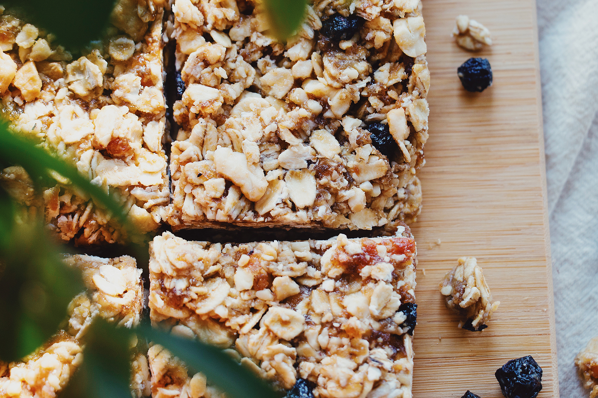 Homemade granola bars on wooden pan