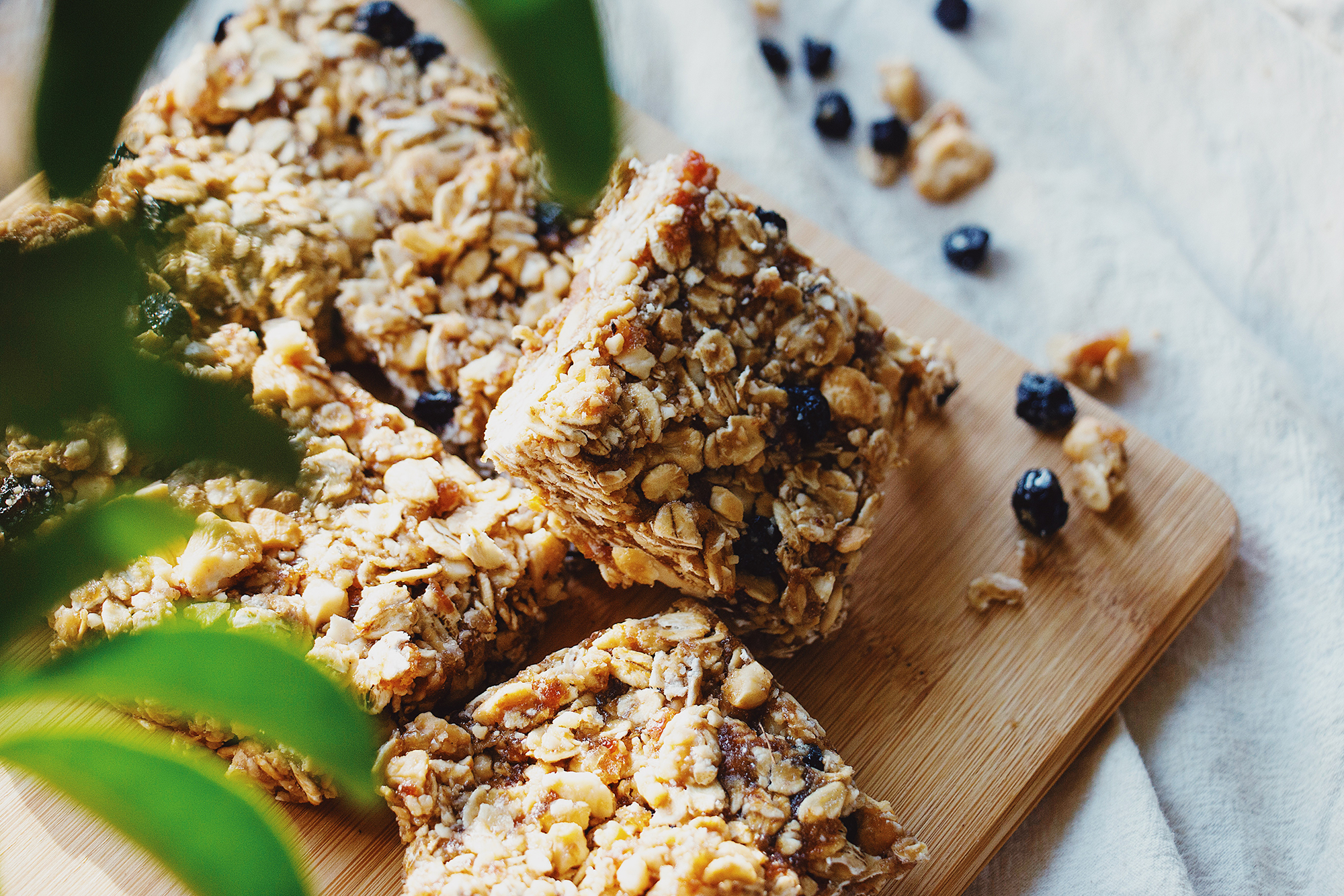 Granola bars, cut and stacked on wooden tray